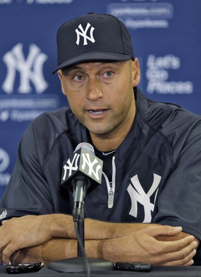 Photo - New York Yankees shortstop Derek Jeter answers a question during a news conference Wednesday, Feb. 19, 2014, in Tampa, Fla. Jeter has announced he will retire at the end of the 2014 season. (AP Photo/Chris O'Meara)