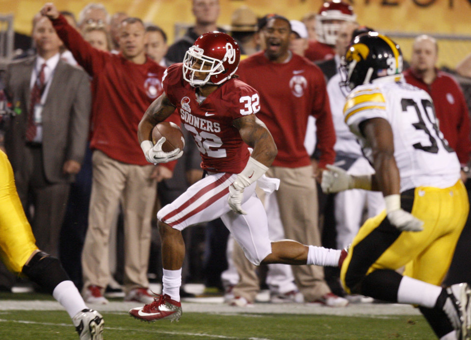 Photo - Oklahoma's Jamell Fleming (32) runs back an interception during the Insight Bowl college football game between the University of Oklahoma (OU) Sooners and the Iowa Hawkeyes at Sun Devil Stadium in Tempe, Ariz., Friday, Dec. 30, 2011. Photo by Bryan Terry, The Oklahoman