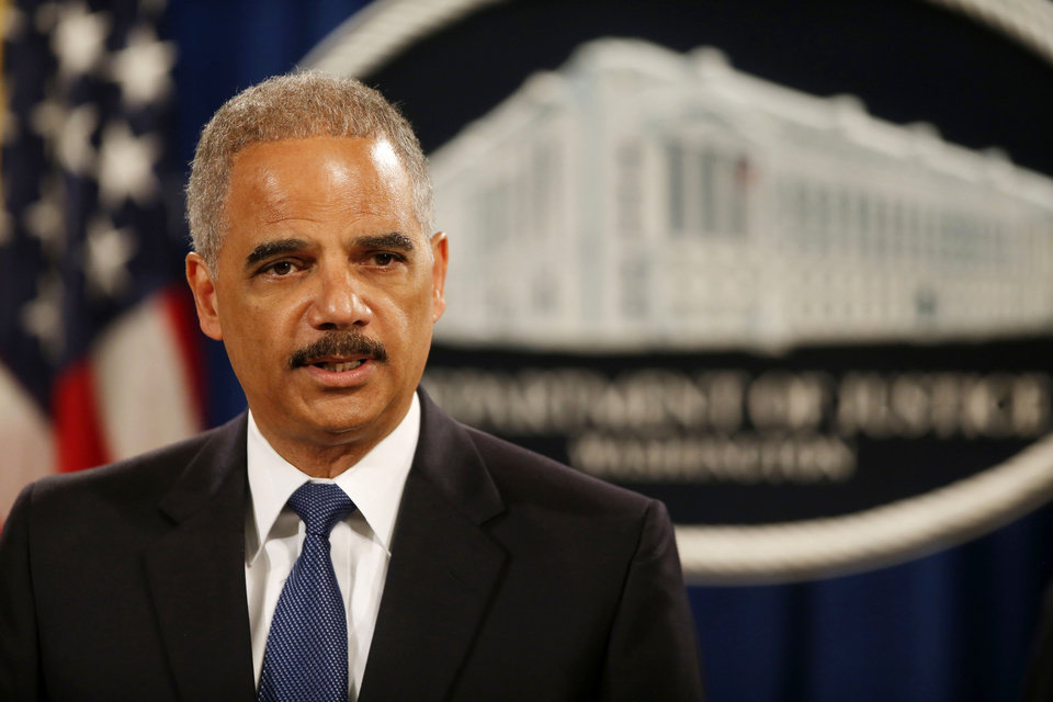 Photo - Attorney General Eric Holder speaks at a news conference at the Justice Department in Washington, Monday, May 19, 2014. Holder announced that a U.S. grand jury has charged five Chinese hackers with economic espionage and trade secret theft, the first-of-its-kind criminal charges against Chinese military officials in an international cyber-espionage case. (AP Photo/Charles Dharapak)