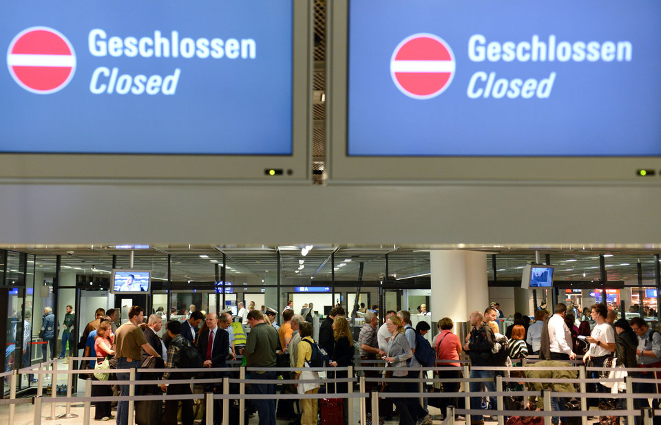 Photo - The security check remains closed after a strike of the security personnel at the airport in Frankfurt, central Germany, Friday, Feb. 21, 2014. More than three dozen flights have been canceled at Germany's largest airport after security personnel walked out to press their demand for higher wages ahead of a new round of negotiations. (AP Photo/dpa, Arne Dedert)