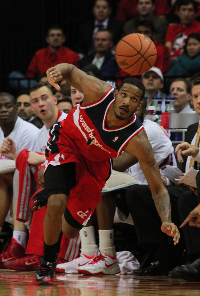 Photo - Washington Wizards forward Trevor Ariza chases a loose ball during play against the Houston Rockets in the second half of an NBA basketball game in Houston, Wednesday, Feb. 12, 2014. (AP Photo/Richard Carson)