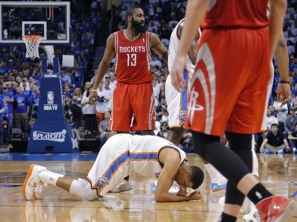 Oklahoma City\'s Thabo Sefolosha (2) reacts after being hit during Game 2 in the first round of the NBA playoffs between the Oklahoma City Thunder and the Houston Rockets at Chesapeake Energy Arena in Oklahoma City, Wednesday, April 24, 2013. Photo by Chris Landsberger, The Oklahoman