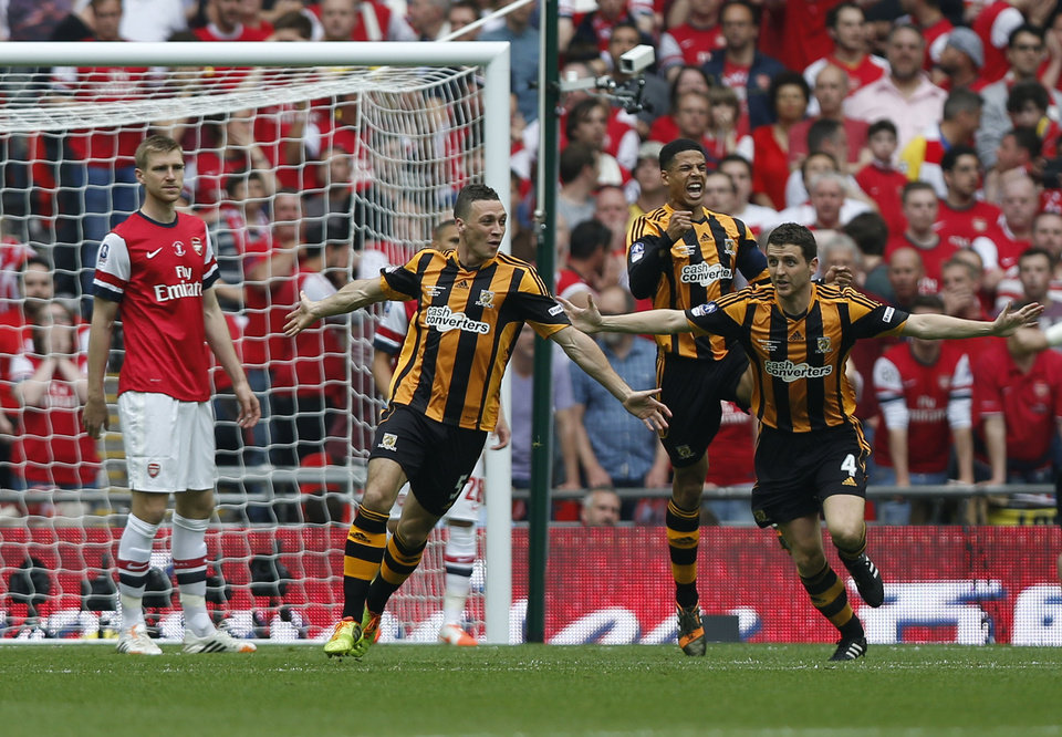 Photo - Hull City's James Chester, second left, celebrates his goal against Arsenal with teammates during their English FA Cup final soccer match at Wembley Stadium in London, Saturday, May 17, 2014. (AP Photo/Sang Tan)