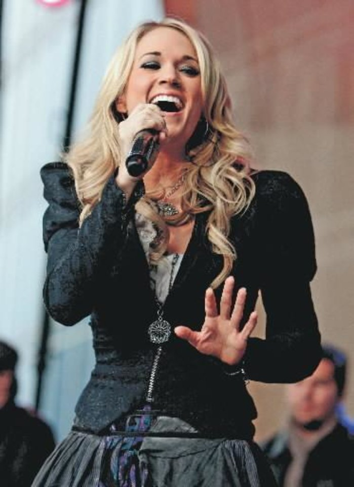 Carrie  Underwood performs at an outdoor show in Nashville, Tenn., Tuesday, Nov. 10, 2009. (AP Photo/Mark Humphrey)