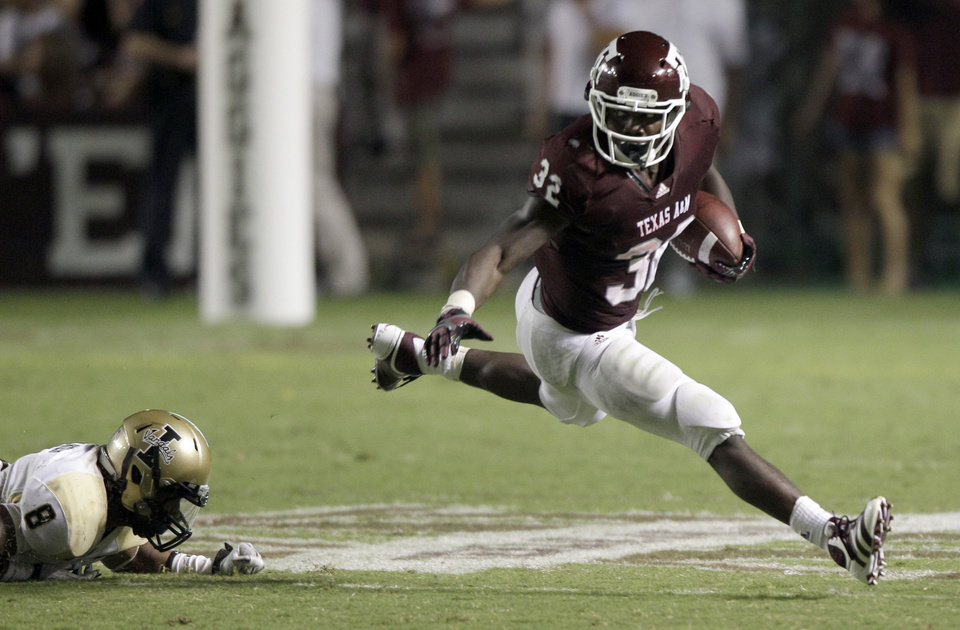 Texas A&M running back Cyrus Gray (32) breaks away from Idaho cornerback Dion Bass (8) during the fourth quarter of an NCAA college football game Saturday, Sept. 17, 2011, in College Station, Texas. (AP Photo/David J. Phillip) ORG XMIT: TXDP111