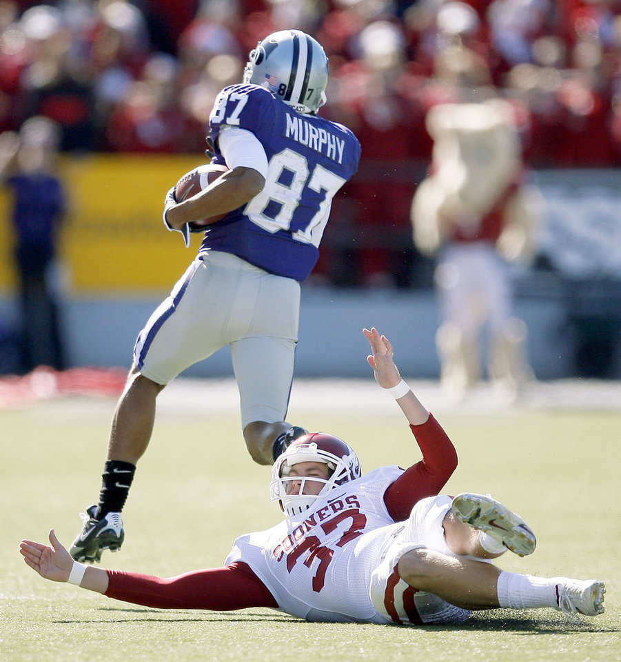 Kansas State's Deon Murphy returns a kickoff for a touchdown as OU's Matthew Moreland misses the tackle earlier this season. Special teams has been weak spot for the Sooners this season. Photo by Bryan Terry, The Oklahoman