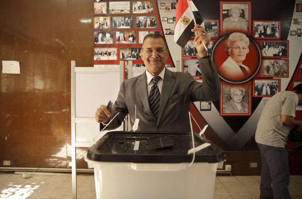 Photo - An Egyptian casts his ballot for President in an election that comes nearly a year after the military's ouster of the nation's first freely elected president, the Islamist Mohammed Morsi, in Cairo, Egypt, Monday, May 26, 2014. The man who removed Morsi, retired military chief Field Marshal Abdel-Fattah el-Sissi, is practically assured of a victory in the vote. (AP Photo/Maya Alleruzzo)