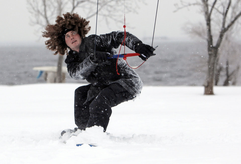Photo - Chris Roberts is pulled by a power kite on a snowboard at Lake Hefner during a winter storm in Oklahoma City, Friday, January 29, 2010. Photo by Nate Billings, The Oklahoman