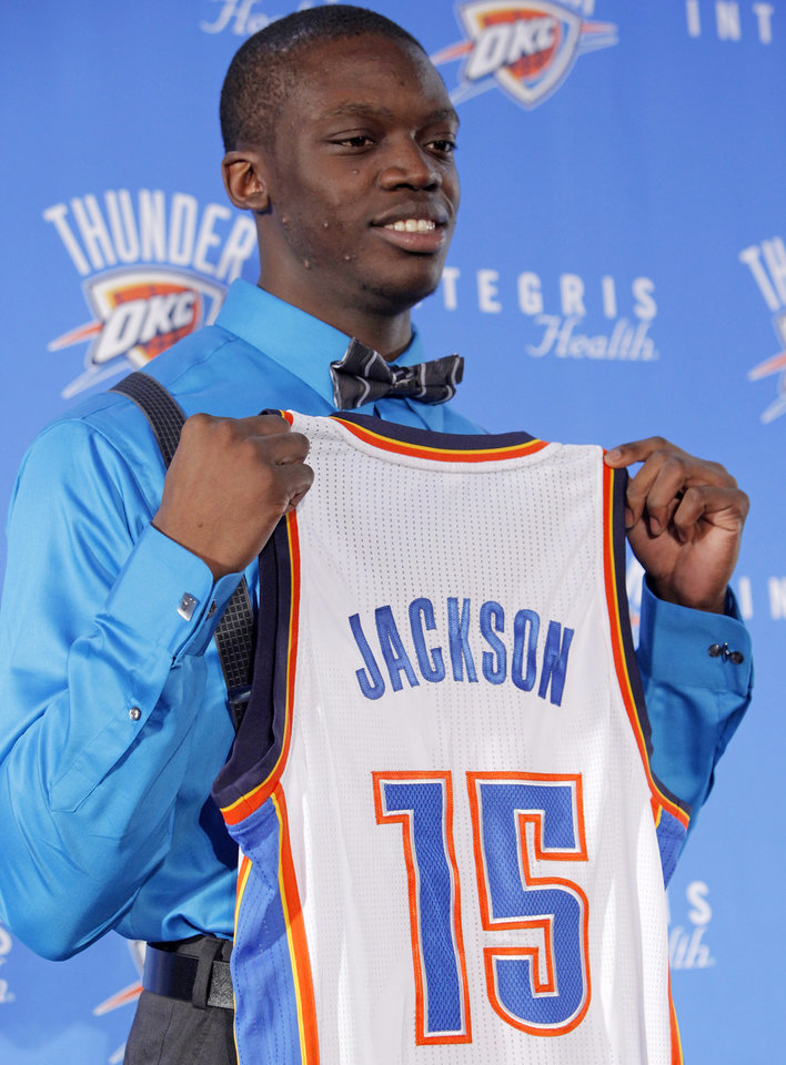 Photo - Oklahoma City Thunder draft pick Reggie Jackson holds his jersey during a news conference at the Boys and Girls Club of Oklahoma County in Oklahoma City, Saturday, June 25, 2011. The Thunder selected Reggie Jackson with the 24th pick in this year's NBA draft. Photo by Nate Billings, The Oklahoman