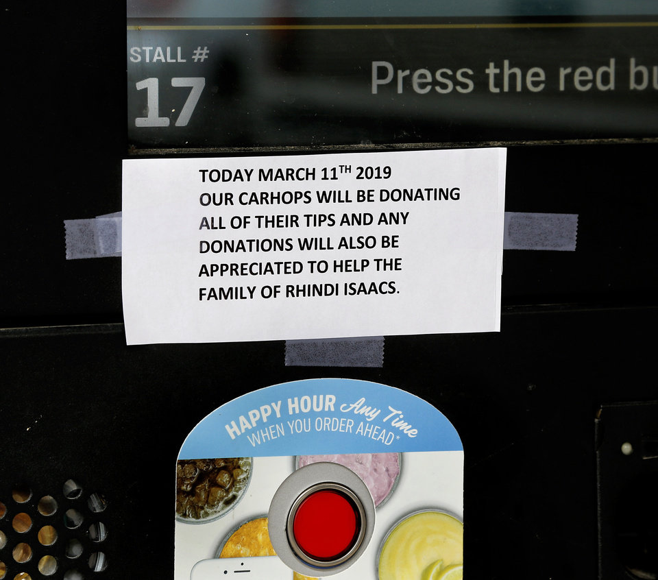 Photo - Sign taped to the menu panel at the Sonic Drive-In in Konawa Monday afternoon, March 11, 2019. Konawa Middle School athlete Rhindi Kay Isaacs, 12, was among three people who died in a fiery, head-on collision Friday evening. The Konawa Public School District said six students from the  junior high school girls softball team were aboard the bus  traveling home at the time of the crash. The team's coach was driving the bus when it was struck by an SUV on SH 377, between Bowlegs and Konawa, in Seminole County. The Oklahoma Highway Patrol said the SUV was traveling in the northbound lane just after 7 p.m. when it swerved and collided with a Konawa School activity bus after the driver of the SUV swerved when passing another vehicle, 