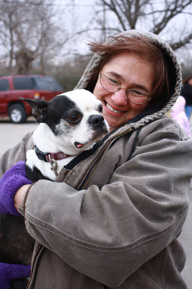 Kathy Shatley waits in line Saturday to buy a pet license for her Boston terrier Baby Ruth. PHOTO BY LYNETTE LOBBAN, FOR THE OKLAHOMAN <strong></strong>