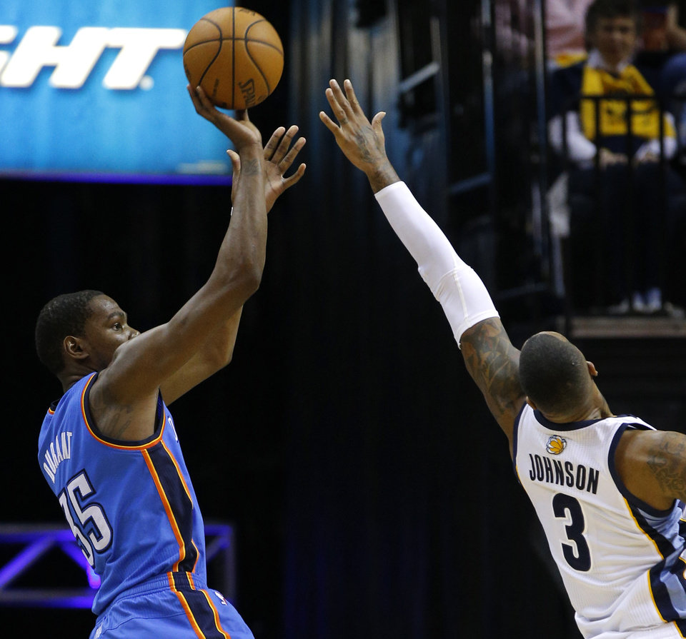 Photo - Oklahoma City's Kevin Durant (35) shoots over Memphis' James Johnson (3) during Game 6 in the first round of the NBA playoffs between the Oklahoma City Thunder and the Memphis Grizzlies at FedExForum in Memphis, Tenn., Thursday, May 1, 2014. Oklahoma City won 104-84. Photo by Bryan Terry, The Oklahoman