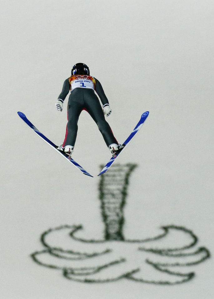 Photo - United States' Sarah Hendrickson makes the first attempt during the women's normal hill ski jumping final at the 2014 Winter Olympics, Tuesday, Feb. 11, 2014, in Krasnaya Polyana, Russia. (AP Photo/Dmitry Lovetsky)