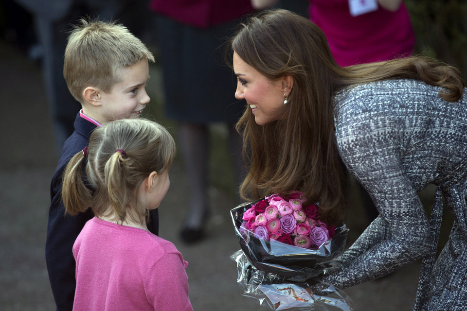 Photo - Britain's Kate, The Duchess of Cambridge receives flowers, as she leaves after a visit to Hope House, in London,  Tuesday, Feb. 19, 2013. As patron of Action on Addiction, the Duchess was visiting Hope House, a safe, secure place for women to recover from substance dependence.   (AP Photo/Matt Dunham)