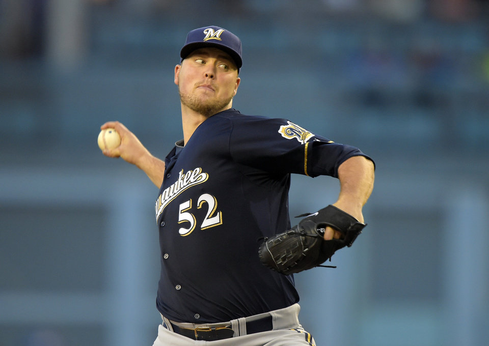 Photo - Milwaukee Brewers starting pitcher Jimmy Nelson throws during the first inning of a baseball game against the Los Angeles Dodgers, Friday, Aug. 15, 2014, in Los Angeles. (AP Photo/Mark J. Terrill)