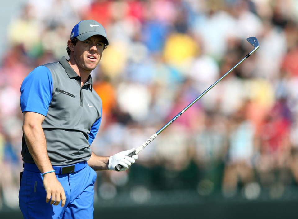 Photo - Rory McIlroy of Northern Ireland watches his shot off the 4th tee during the first day of the British Open Golf championship at the Royal Liverpool golf club, Hoylake, England, Thursday July 17, 2014. (AP Photo/Scott Heppell)