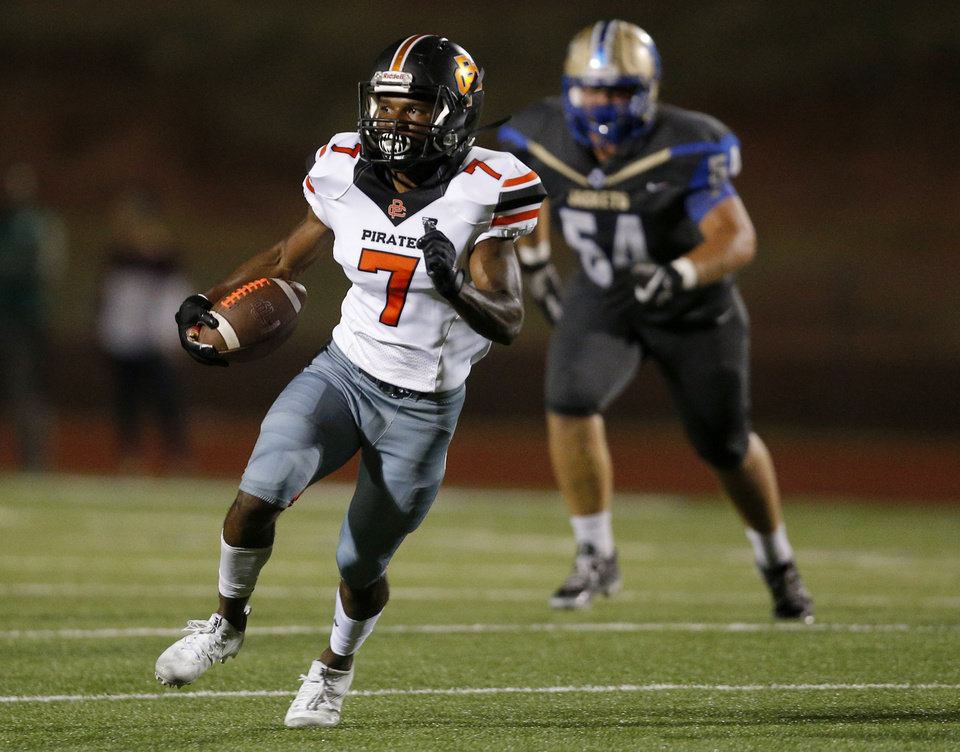 Photo - Putnam City's Keaire Wilkins rushes after a reception during the high school football game between Choctaw and Putnam City at Choctaw High School in Choctaw, Okla.,  Friday, Sept. 22, 2017. Photo by Sarah Phipps, The Oklahoman
