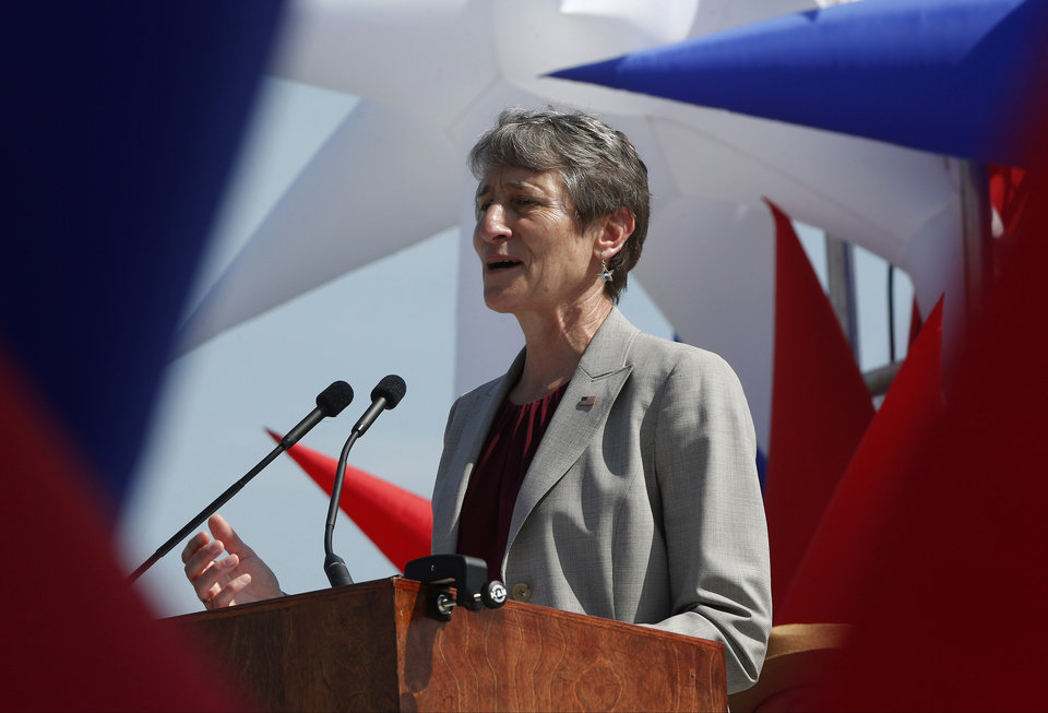 Photo - Interior Secretary Sally Jewell speaks at the Washington Monument in Washington, Monday, May 12, 2014, during a ceremony to celebrate its re-opening. The monument, which sustained damage from an earthquake in August 2011, reopened to the public today. (AP Photo)