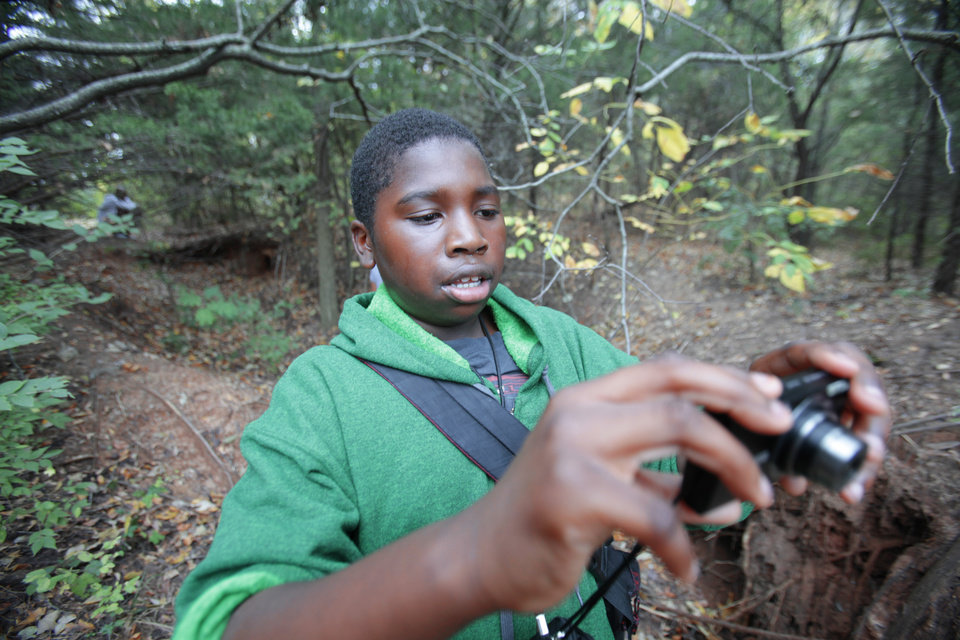 "Kendre, 10, takes photos during an outing with The Boys and Girls Club's new program called ""Parks in Focus"" at the Stinchcomb Wildlife Refuge. Photo By David McDaniel/The Oklahoman <strong>David McDaniel - The Oklahoman</strong>"