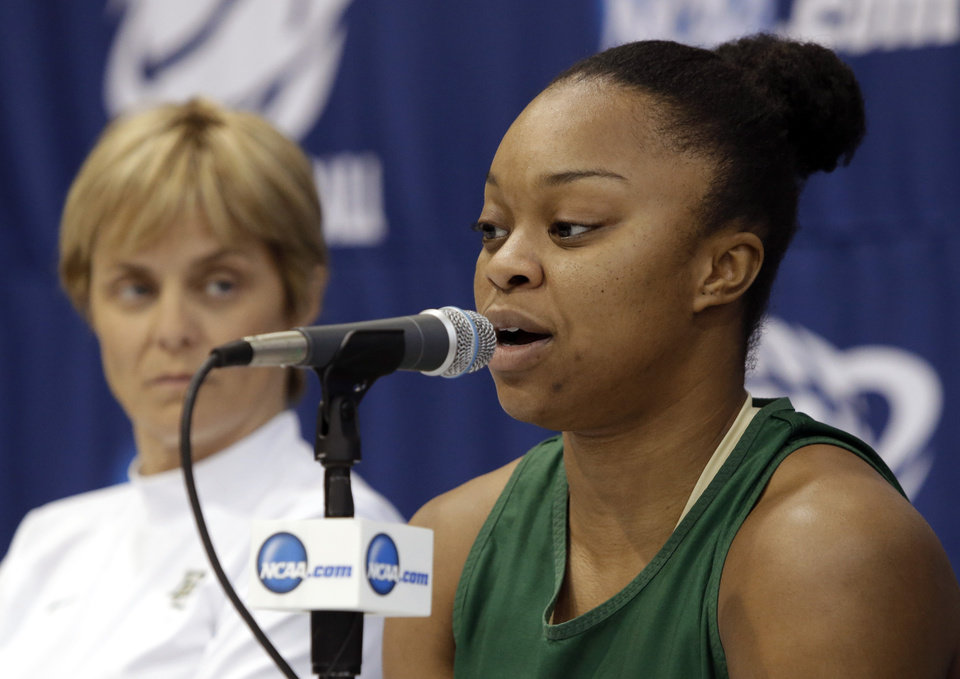 Photo - Baylor's Odyssey Sims, right, responds to a question as head coach Kim Mulkey listens during an NCAA college basketball tournament news conference on Sunday, March 23, 2014, in Waco, Texas. Baylor is scheduled to play California on Monday. (AP Photo/Tony Gutierrez)