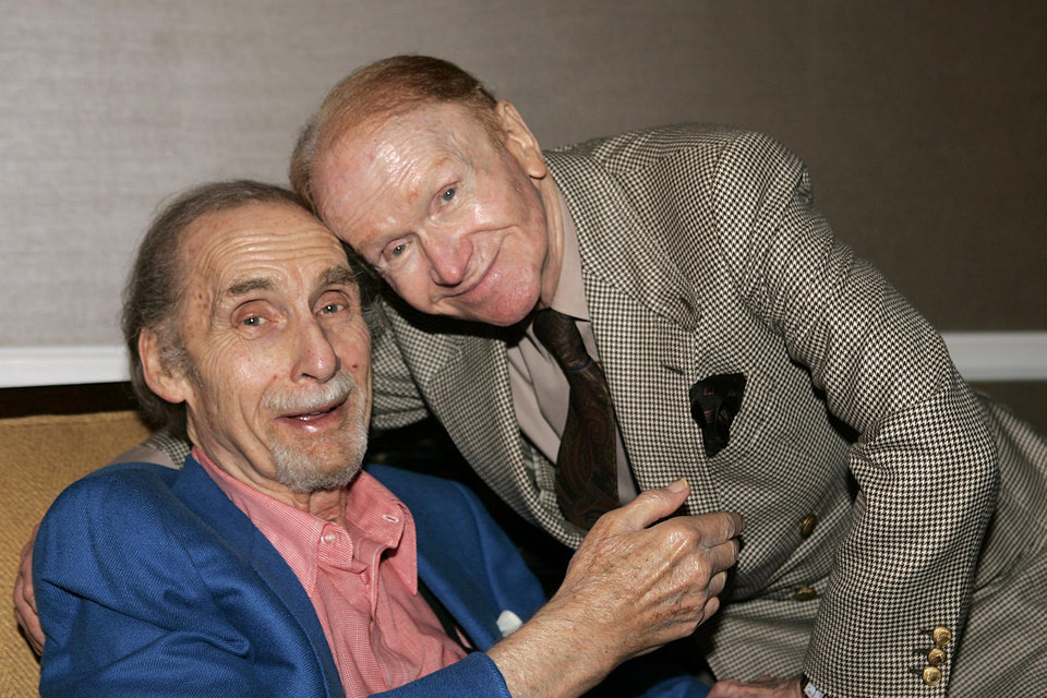 Photo - FILE - This July 12, 2005 file photo shows comedians Sid Caesar, left, and Red Buttons at the Television Critics Association PBS Press Tour in Beverly Hills, Calif. Caesar, whose sketches lit up 1950s television with zany humor, died Wednesday, Feb. 12, 2014. He was 91.  (AP Photo/Mathew Imaging, Mark W. Davis, File)