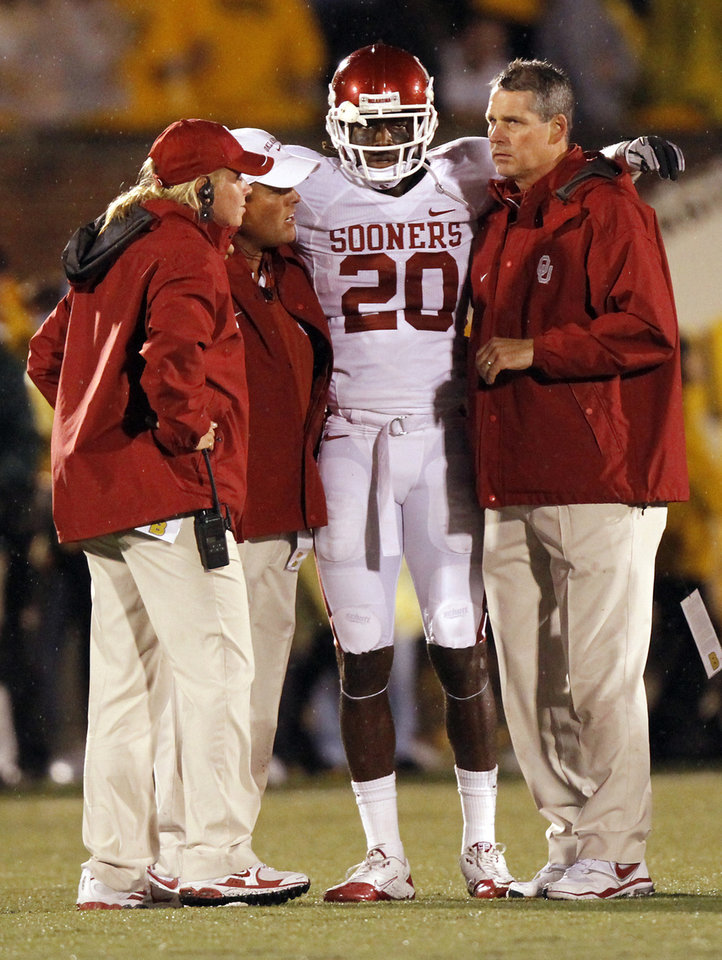 Photo - Trainers help Quinton Carter off the field after being injured on a tackle during the second half of the college football game between the University of Oklahoma Sooners (OU) and the University of Missouri Tigers (MU) on Saturday, Oct. 23, 2010, in Columbia, Mo. Oklahoma lost the game 36-27. Photo by Chris Landsberger, The Oklahoman