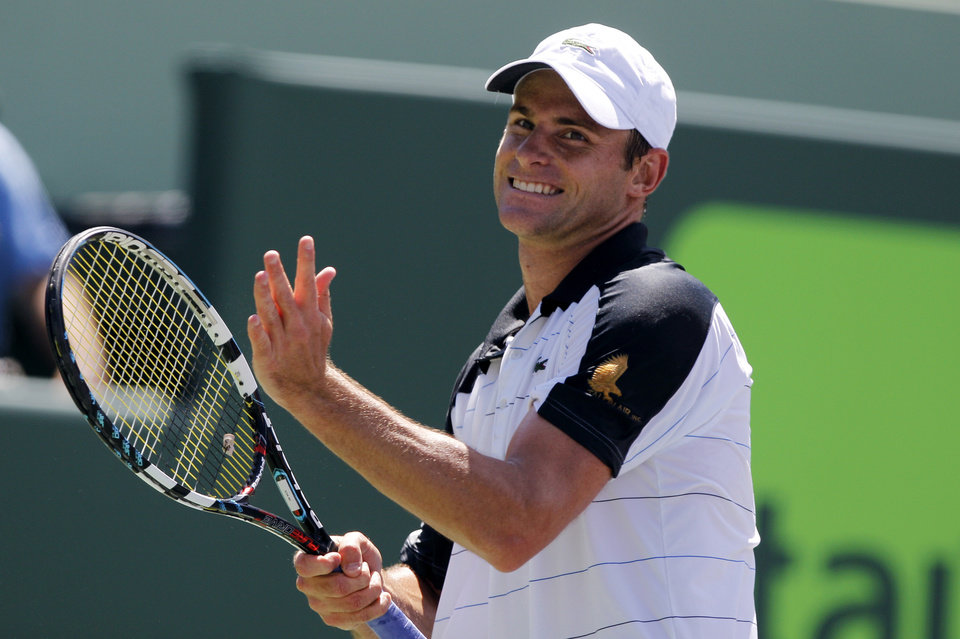 Photo -  Andy Roddick reacts after missing a point against Gilles Muller of Luxembourg, during the Sony Ericsson Open tennis tournament, Saturday, March 24, 2012, in Key Biscayne, Fla. Roddick  won the match 6-3, 6-2. (AP Photo/Lynne Sladky)