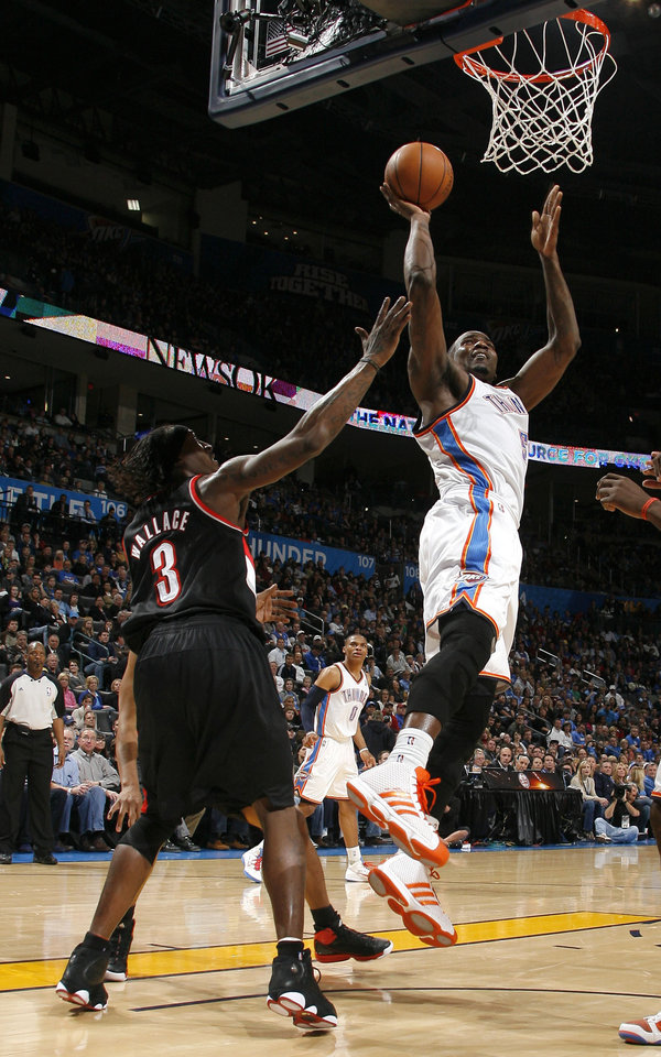 Photo - Oklahoma City's Kendrick Perkins (5) shoots over Portland's Gerald Wallace (3) during the NBA game between the Oklahoma City Thunder and the Portland Trailblazers, Sunday, March 27, 2011, at the Oklahoma City Arena. Photo by Sarah Phipps, The Oklahoman