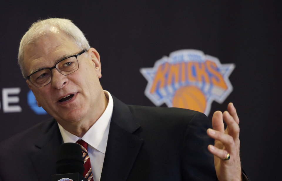 Photo - Phil Jackson, the new president of the New York Knicks, answers questions during a news conference, Tuesday, March 18, 2014 in New York. Jackson, who won two NBA titles as a player with the Knicks, also won 11 championships while coaching the Chicago Bulls and the Los Angeles Lakers. (AP Photo/Mark Lennihan)
