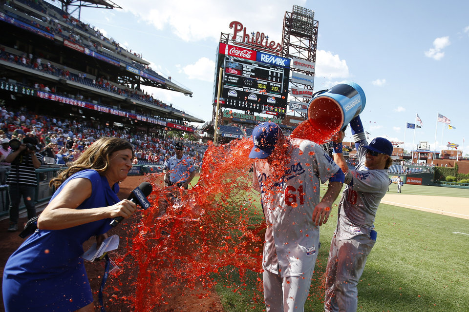 Photo - Los Angeles Dodgers starting pitcher Josh Beckett, center, is doused by second baseman Justin Turner, right, after Beckett pitched a no-hitter baseball game against the Philadelphia Phillies, Sunday, May 25, 2014, in Philadelphia. Los Angeles won 6-0. Beckett pitched the first no-hitter of his career and the first in the majors this season. (AP Photo/Matt Slocum)