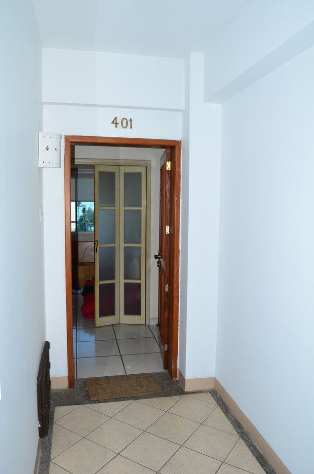 Photo - A door remains open at the entrance to the high-rise condominium where famed drug boss Joaquin Guzman Loera