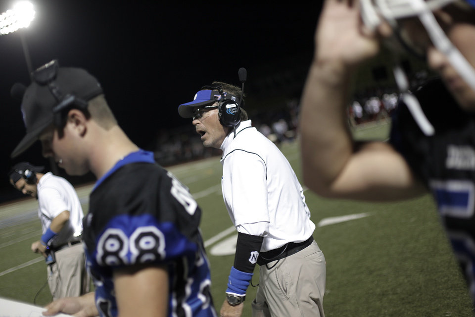 Photo - Deer Creek head coach Grant Gower walks off the field during a high school football game between Deer Creek and Ardmore at Deer Creek Stadium in Edmond, Okla., Friday, Nov. 9, 2012.  Photo by Garett Fisbeck, The Oklahoman