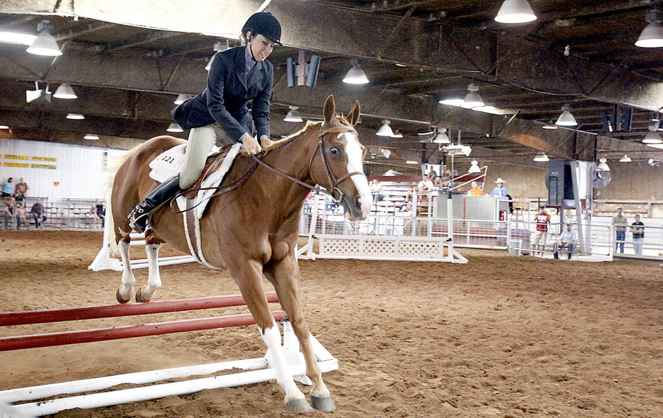 Brittney Taylor rides Tequilla Talkng during the Cleveland County Free Fair Horse Show at the Cleveland County County Fair Barn, Saturday, Aug. 28, 2010, in Norman, Okla. Photo by Sarah Phipps, The Oklahoman