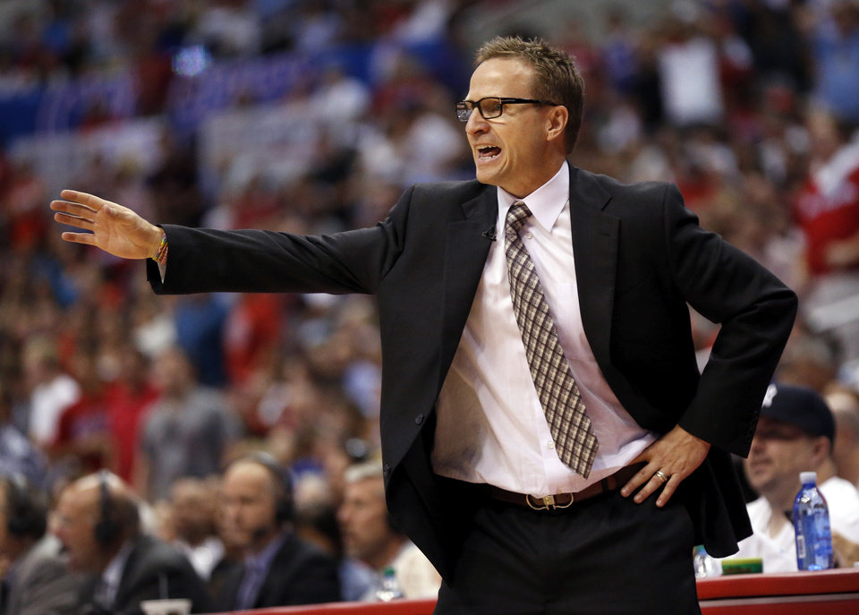 Photo - Oklahoma City coach Scott Brooks gives instructions to his team during Game 4 of the Western Conference semifinals in the NBA playoffs between the Oklahoma City Thunder and the Los Angeles Clippers at the Staples Center in Los Angeles, Sunday, May 11, 2014. Photo by Nate Billings, The Oklahoman