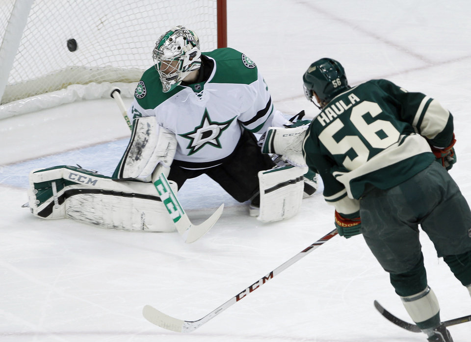 Photo - A shot by Minnesota Wild left wing Erik Haula (56), of Finland, gets past Dallas Stars goalie Kari Lehtonen, of Finland, for a goal during the first period of an NHL hockey game in St. Paul, Minn., Saturday, Jan. 18, 2014.  (AP Photo/Ann Heisenfelt)