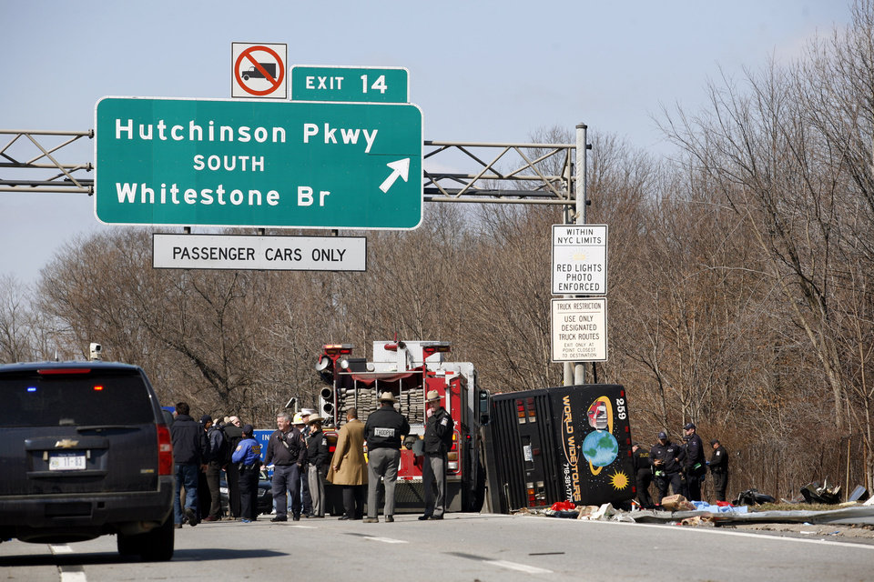 FILE--In this photo from Saturday, March 12, 2011, emergency personnel investigate the scene of a bus crash on Interstate-95 in the Bronx borough of New York .  A verdict has been reached in a manslaughter case against the bus driver Ophadell Williams, charged in the crash that killed 15 passengers.   Williams has pleaded not guilty. He says a tractor-trailer cut him off and he lost control. The bus carrying gamblers coming from a Connecticut casino was sheared open like a sardine can when it struck a pole. (AP Photo/David Karp, File)