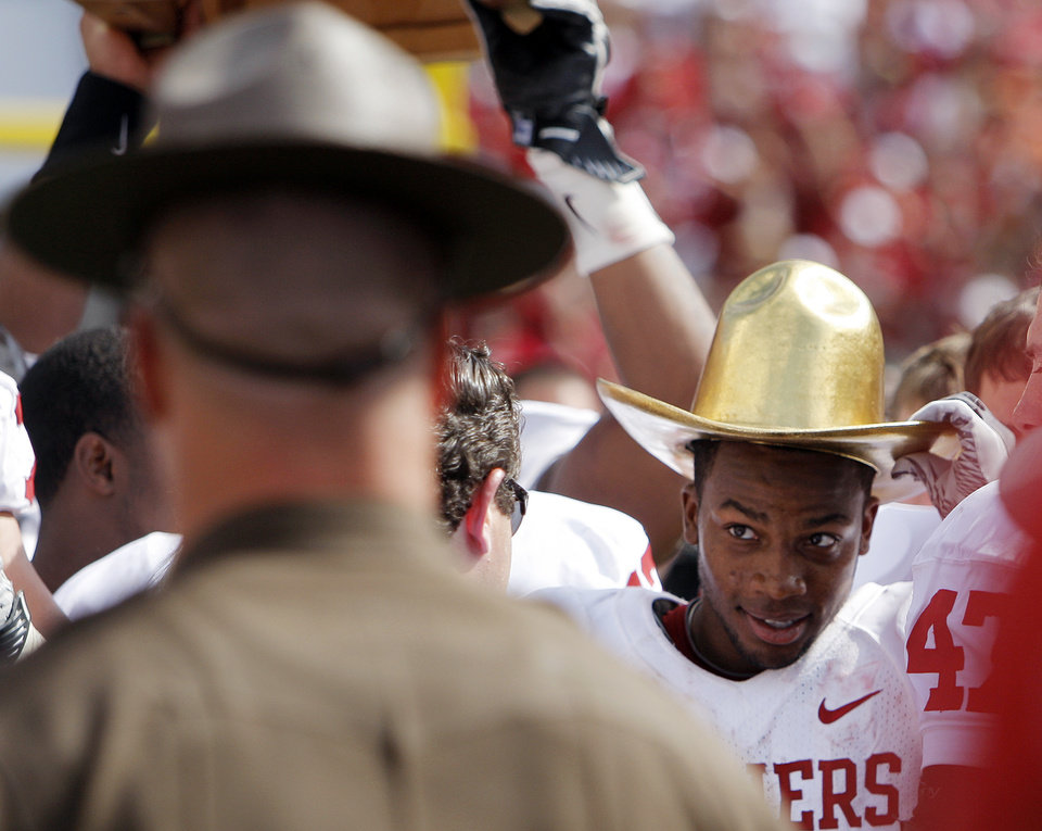 OU's Ryan Broyles wears the Golden Hat trophy after the Red River Rivalry college football game between the University of Oklahoma Sooners (OU) and the University of Texas Longhorns (UT) at the Cotton Bowl in Dallas, Friday, Oct. 7, 2011. OU won, 55-17. Photo by Nate Billings, The Oklahoman