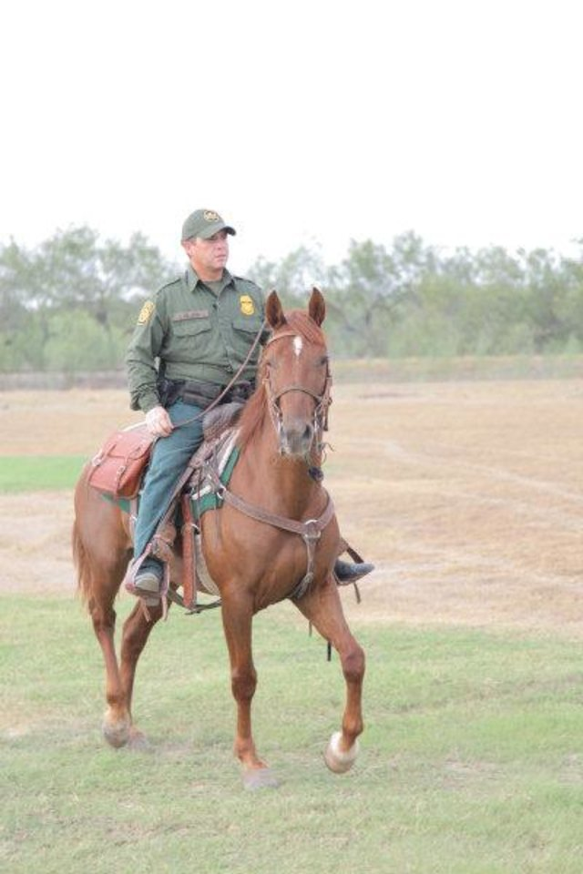 Photo - Border Patrol Agent J. DeLeon on inmate-trained mustang Junior.  PHOTO PROVIDED