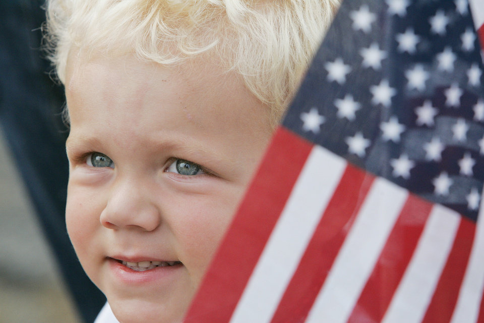 Mason Keller ,2, smiles for a photo by his mother before the start of the Brookhaven 4th of July parade Saturday, July 4, 2009, in Norman. Photo by Jaconna Aguirre, The Oklahoman.
