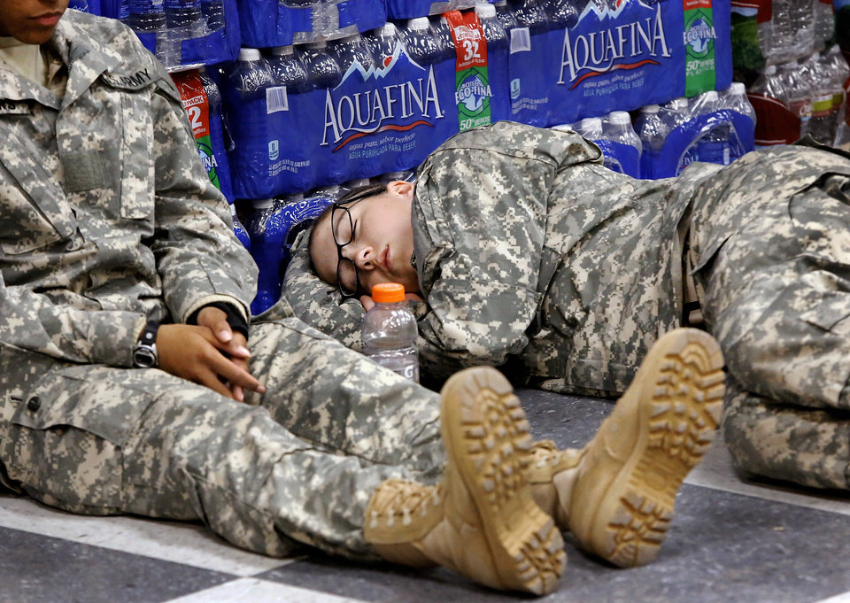 Pvt. Drenna Sawyer uses the tile floor in the military welcome center as a perfect place to squeeze in some rest while waiting for her plane to arrive.  Nearly 700 soldiers from Ft. Sill, most of whom had recently completed their basic training,  arrived at Will Rogers World Airport on buses in pre-dawn hours Thursday,  Dec. 20, 2012, to catch flights to join join their families for the Christmas holidays.  The troops were welcomed by Blue Star Mothers and other volunteers at the YMCA Military Welcome Center, where they were offered pizzas, doughnuts,  chips, sub sandwiches, desserts, hot coffee and cold beverages. Local merchants donated 250 pizzas, 60 dozen doughnuts and the submarine sandwiches.   Photo by Jim Beckel, The Oklahoman