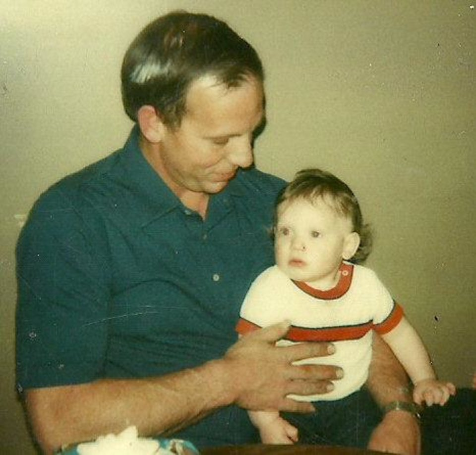 Photo - Brent Whitney as a toddler, sitting on his father Roger's lap. Brent's father developed early-onset Alzheimer's near age 48 and died when he was 55.
