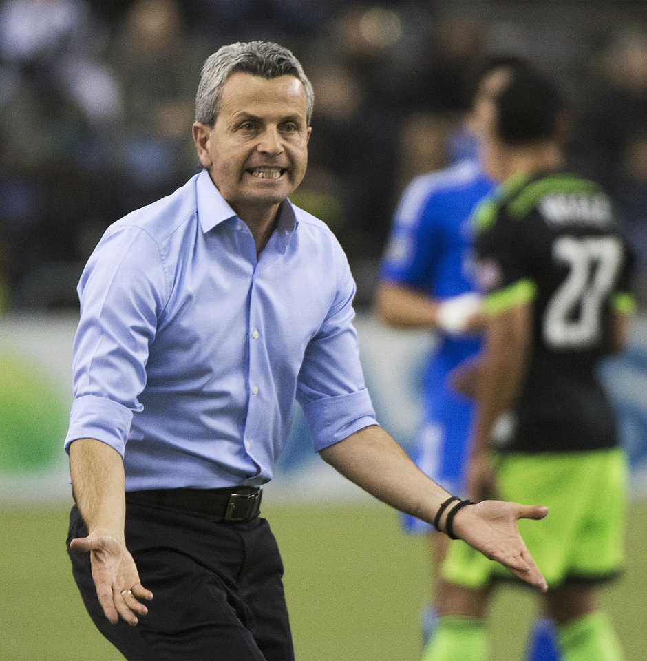 Photo - Montreal Impact's coach Frank Klopas reacts on the sideline during the second half of an MLS soccer game against the Seattle Sounders in Montreal, Sunday, March 23, 2014. (AP Photo/The Canadian Press, Graham Hughes)