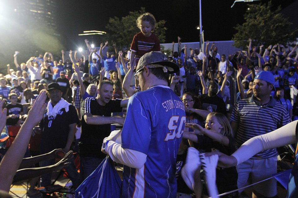 About 5,000 fans gathered April 30 in Thunder Alley during Game 2 against the Dallas Mavericks in the first round of the NBA Playoffs. On Monday, a shooting a few blocks away from the Chesapeake Energy Arena left at least eight people injured. Archive photo by Garett Fisbeck, For The Oklahoman
