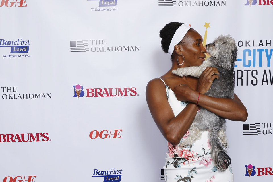 Photo - Venus Williams with her dog, Harry,  at The Oklahoman's All City Prep Sports Awards at the Cox Center. Tuesday, June 26, 2018. Photo by Doug Hoke,The Oklahoman