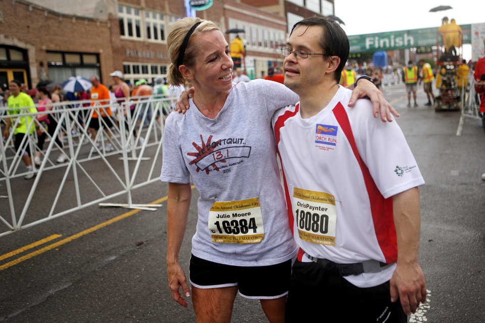 Julie Moore, left, and Chris Paynter embrace after finishing the half marathon during the Oklahoma City Memorial Marathon in Oklahoma City, Sunday, April 29, 2012. Photo by Bryan Terry, The Oklahoman