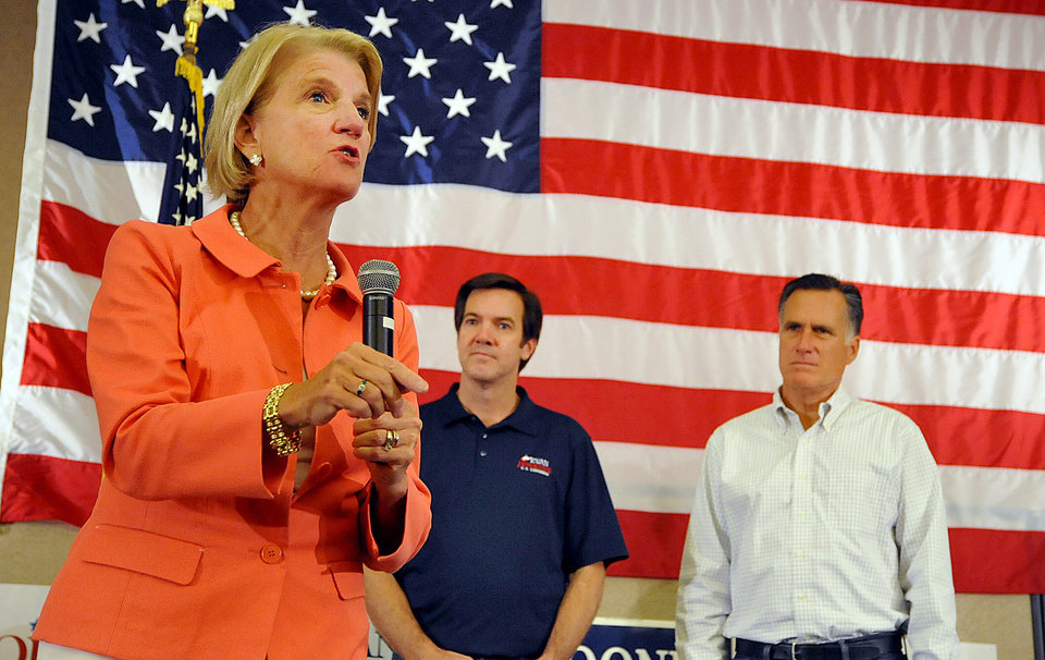 Photo - Congresswoman Shelley Moore Capito as speaks at Tamarack during the Working for Jobs Rally in Beckley, W.Va., Tuesday, Aug. 19, 2014. looking on are Sen. Evan Jenkins and Former Massachusetts Gov. Mitt Romney.  (AP Photo/Chris Tilley)