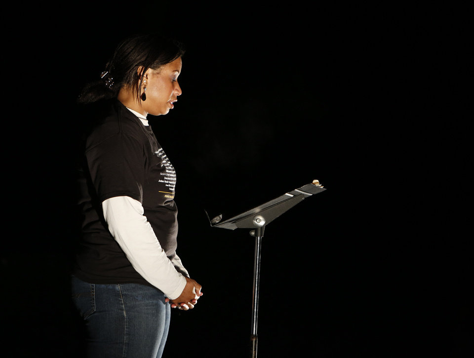 Madinah Hazim-Adams, of Oklahoma City, shares her story during a candlelight vigil in honor of Mental Illness Awareness Week that was held in Edmond. PHOTO BY GARETT FISBECK, THE OKLAHOMAN <strong>Garett Fisbeck - THE OKLAHOMAN</strong>
