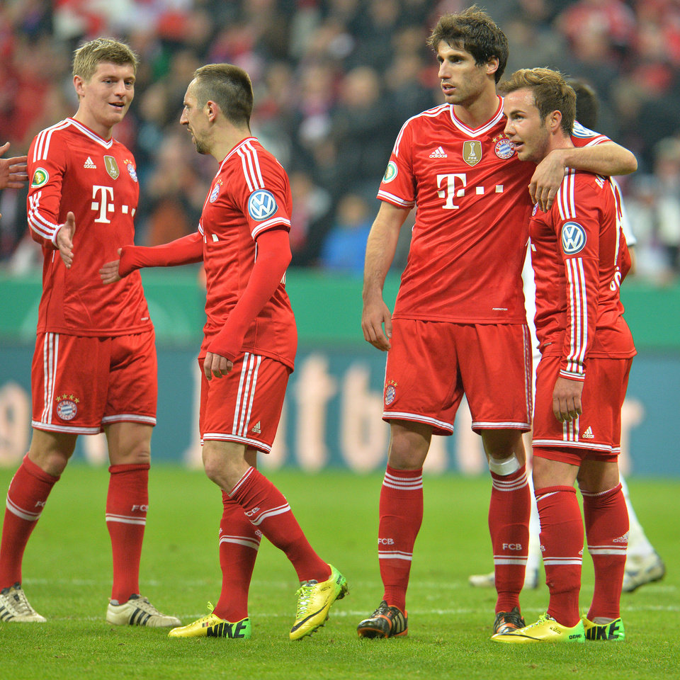 Photo - Munich's Toni Kroos, Franck Ribery of France, Javier Martinez of Spain and Mario Goetze, from left, celebrate after scoring during the German soccer cup, DFB Pokal, semifinal soccer match between FC Bayern Munich and FC Kaiserslautern in the Allianz Arena in Munich, Germany, on Wednesday, April 16. 2014. Bayern won 5-1. (AP Photo/Kerstin Joensson)
