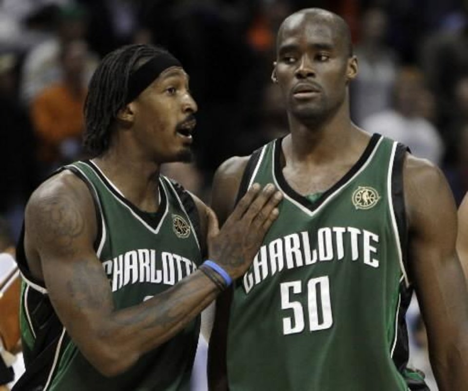 Photo -  Charlotte  Bobcats guard Gerald Wallace, left, talks with teammate Emeka Okafor in the closing seconds of the  Bobcats' 101-98 win over the Philadelphia 76ers in an NBA basketball game in  Charlotte, N.C., Tuesday, April 7, 2009. (AP Photo/Chuck Burton)