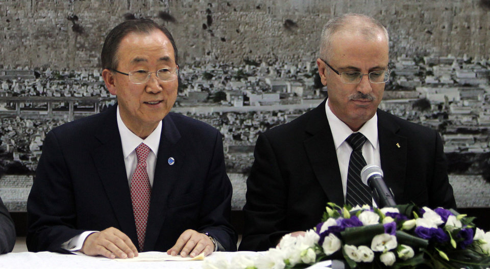 Photo - United Nations Secretary-General Ban Ki-moon, left, speaks during a meeting with Palestinian Prime Minister Rami Hamdallah, right, in Ramallah, West Bank, Tuesday, July 22, 2014, regarding the Israel-Hamas conflict. (AP Photo/Alaa Badarneh, Pool)